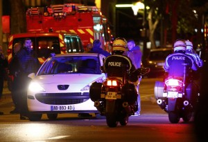 Police patrol on the Boulevard Voltaire following a series of deadly attacks in  Paris