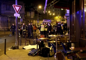 General view of the scene that shows the covered bodies outside a restaurant following a shooting incident in Paris