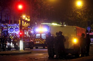 French riot police secure the area near the Bataclan concert hall following a fatal shooting at a restaurant in Paris